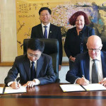 (L to R back row:  Prof Xianzhong Song, Prof Margaret Sheil; front row: Prof Hong Zhang and Prof Scott Sheppard signing the agreement)